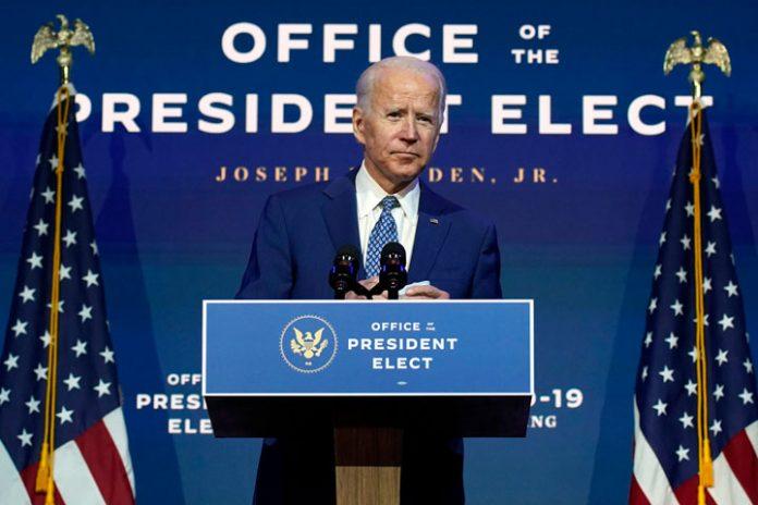 President Elect Joe Biden speaking at a podium