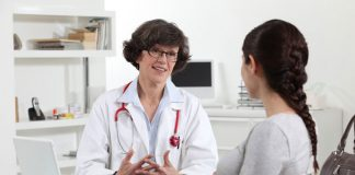 Pregnant woman speaking to her healthcare provider