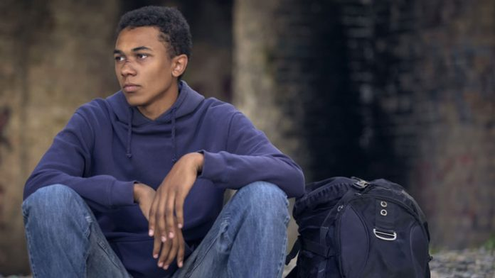 boy sitting alone