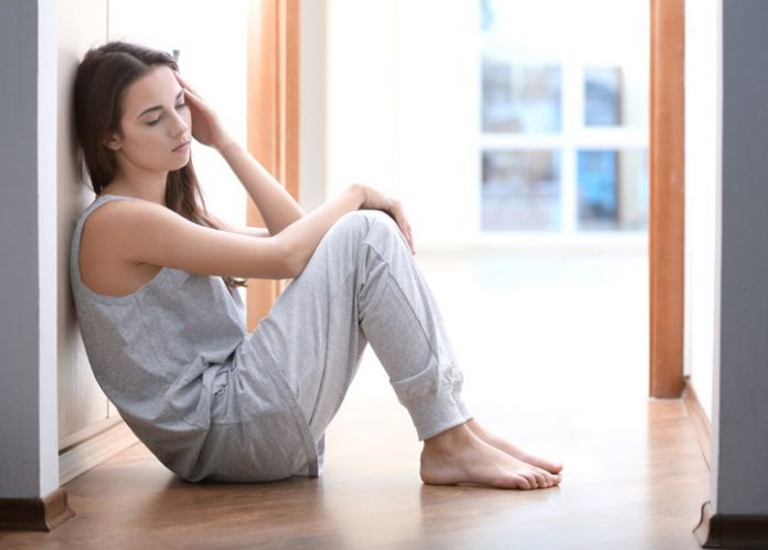 Exhausted woman sitting on the floor