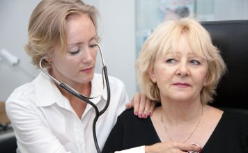 Female provider listening the heart of a female patient