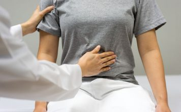 Woman being examined by clinician