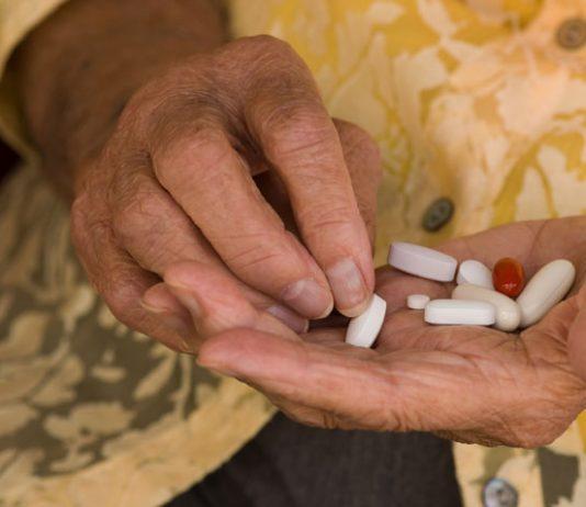 Older woman sorting medications